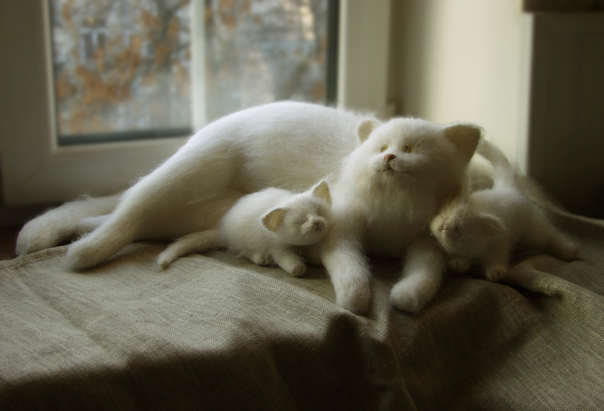 stuffed cat with kittens