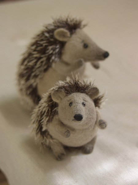 two stuffed hedgehogs