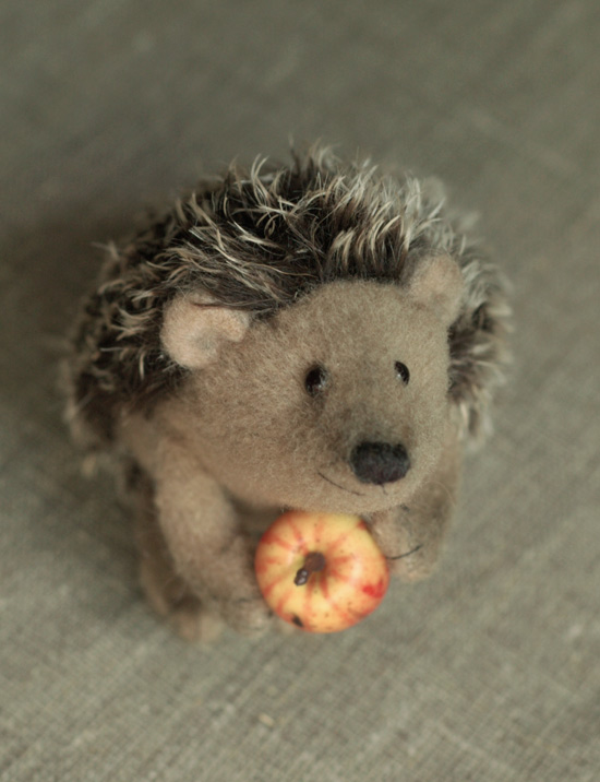 fat hedgehog with an apple