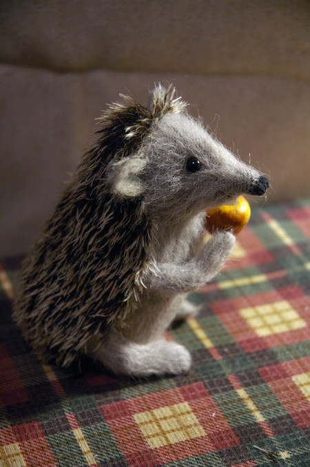 hedgehog holding an apple