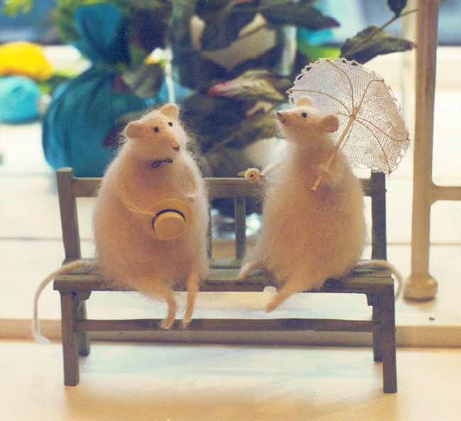two mice on a bench