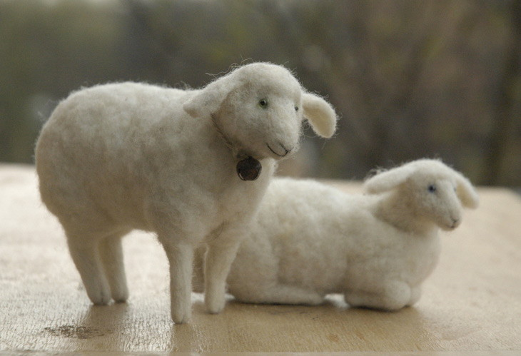 needle felted sheep - sitting and lying down