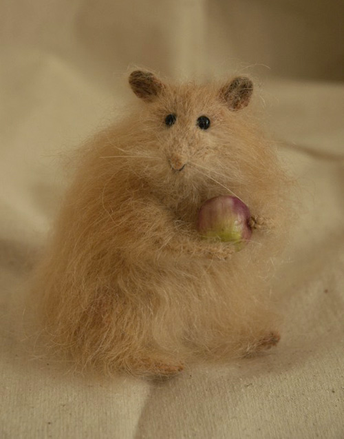 hamster holding an apple