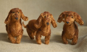 three plush dachshund dogs