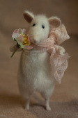 stuffed mouse holding a rose