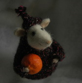 miniature stuffed mouse with a tangerine